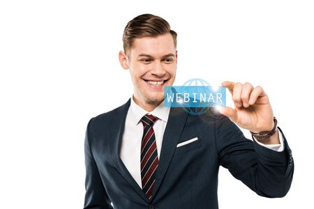 happy businessman gesturing and smiling while looking at webinar lettering on while
