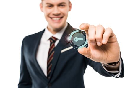 selective focus of happy businessman gesturing and smiling while touching virtual key icon isolated on while