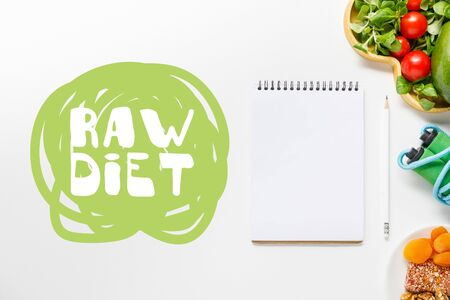 top view of blank notebook near diet food and skipping rope on white background with with raw diet lettering