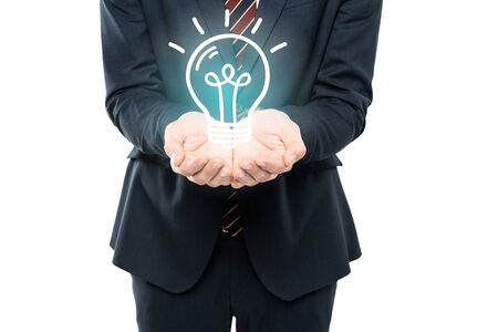 cropped view of businessman with cupped hands near light bulb isolated on white