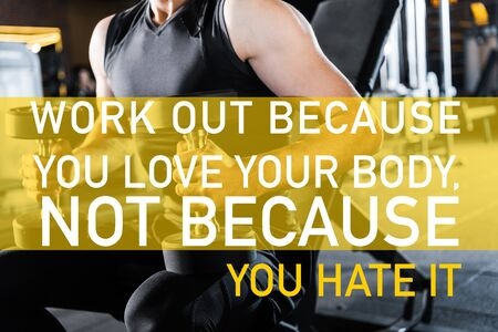 cropped view of athletic man working out with dumbbells in gym with work out because you love your body, not because you hate it illustration Stok Fotoğraf
