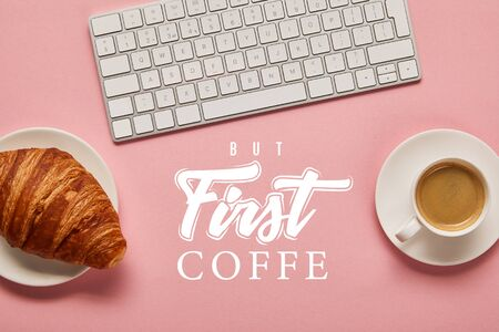 top view of computer keyboard near coffee and croissant on pink background with but first coffee lettering Reklamní fotografie