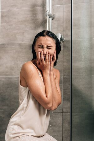 lonely frustrated woman crying in shower at home