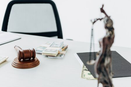 selective focus of gavel of judge near dollar banknotes on table