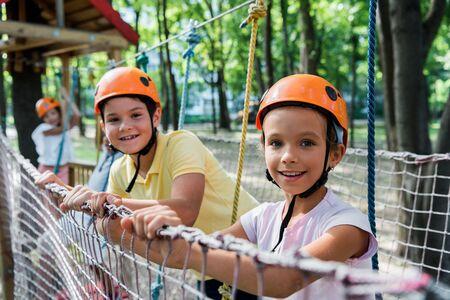 selective focus of happy kids in adventure park
