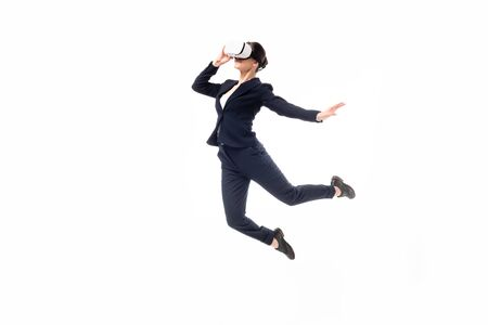 businesswoman in virtual reality headset levitating isolated on white
