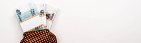 panoramic shot of russian money in plaid vintage wallet on white Reklamní fotografie