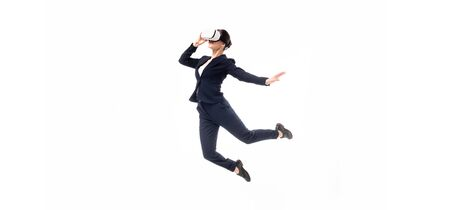 panoramic shot of businesswoman in virtual reality headset levitating isolated on white Standard-Bild