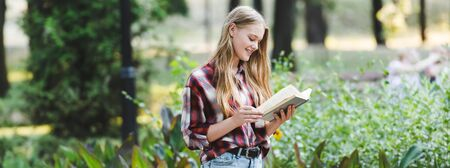panoramic shot of beautiful girl in casual clothes reading book