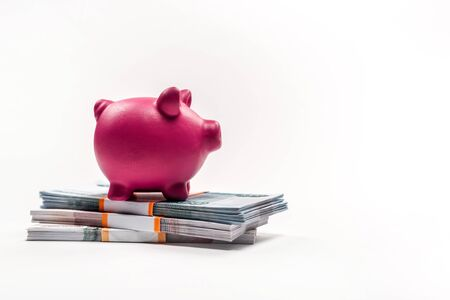 pink piggy bank on stacks with russian money on white Banque d'images