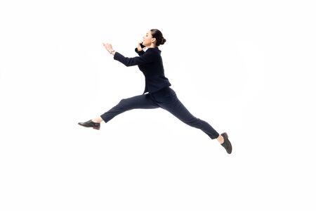 beautiful businesswoman levitating while talking on smartphone isolated on white