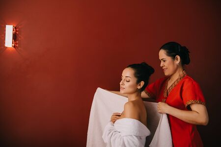 asian woman wrapping with towel attractive woman in spa salon Stock Photo