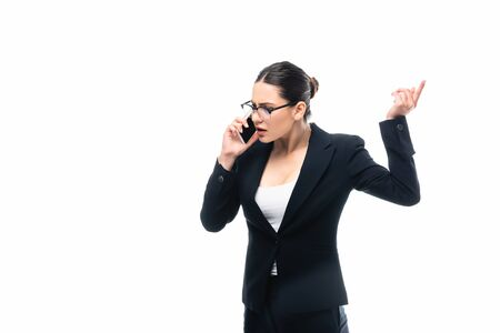 displeased businesswoman gesturing while talking on smartphone isolated on white Stockfoto