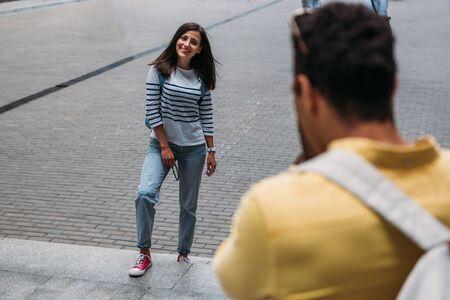 selective focus of bi-racial man near happy woman outside