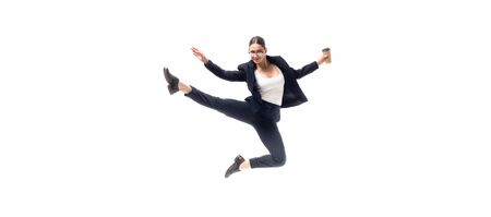 panoramic shot of young businesswoman dancing with coffee to go isolated on white