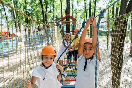 selective focus of positive and multiethnic kids in adventure park