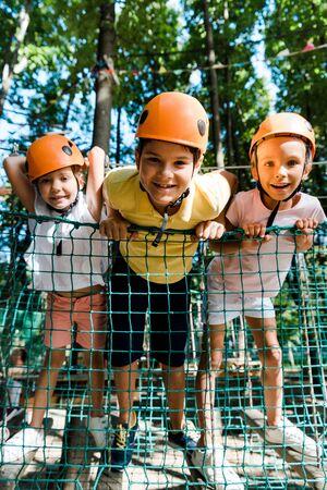 selective focus of cute kid near happy friends in helmets