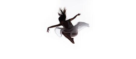 panoramic shot of beautiful ballerina dancing isolated on white