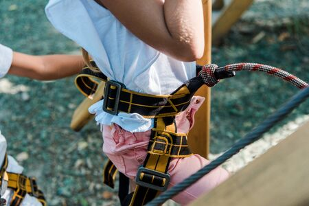 cropped view of kid with height equipment in adventure park 写真素材