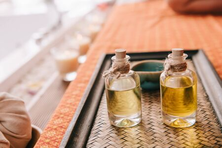 selective focus of bottle with fragrance oils in spa salon