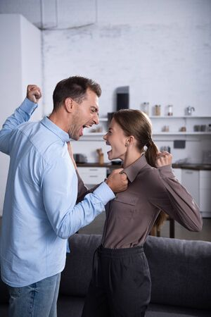 Angry husband and wife fighting and screaming at each other