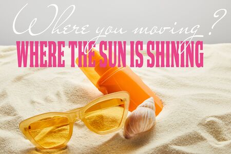 yellow stylish sunglasses and sunscreen in orange bottle on sand with seashell on grey background with where you moving question and where the sun is shining answer