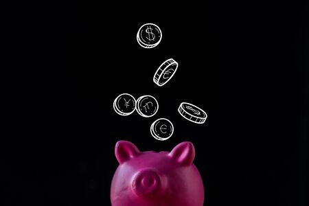 pink piggy bank near coins with dollar and euro signs on black  Reklamní fotografie