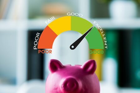 pink piggy bank on wooden desk near colorful speed meter with letters in office
