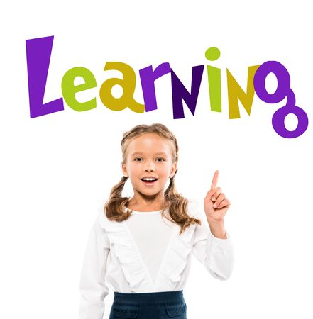 happy kid pointing with finger at learning lettering on white