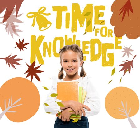 happy schoolkid holding books near time for knowledge lettering on white
