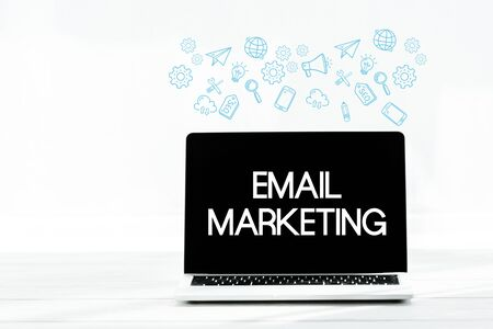 laptop with email marketing on screen on white