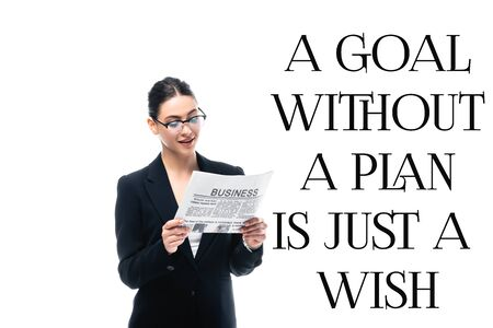 young businesswoman reading newspaper near a goal without a plan is just a wish inscription isolated on white