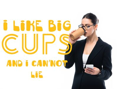 young businesswoman using smartphone and drinking coffee to go near i like big cups and i can not lie lettering isolated on white Reklamní fotografie