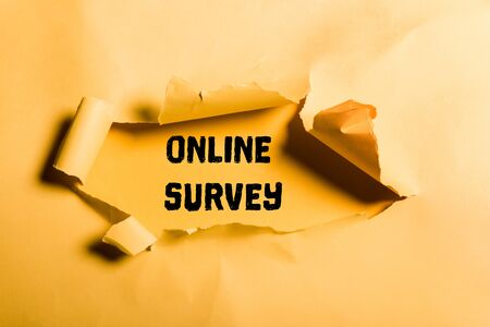 tattered paper with online survey lettering and rolled edges on orange