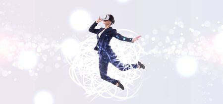 panoramic shot of businesswoman in virtual reality headset jumping on grey background with abstracts cyberspace illustration Stok Fotoğraf