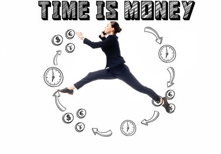 side view of businesswoman talking on smartphone while jumping in frame with money symbols, clocks and arrows, and time is money lettering isolated on white 版權商用圖片