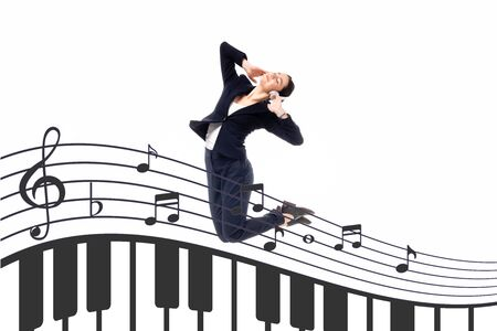 young businesswoman jumping in dance near illustration with music notes and piano keys isolated on white