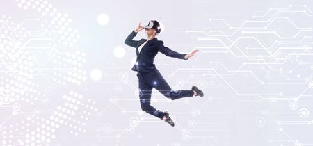 panoramic shot of businesswoman in virtual reality headset levitating on grey background with abstract cyberspace illustration Stock fotó