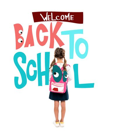 back view of schoolchild standing with pink backpack near welcome back to school lettering on white