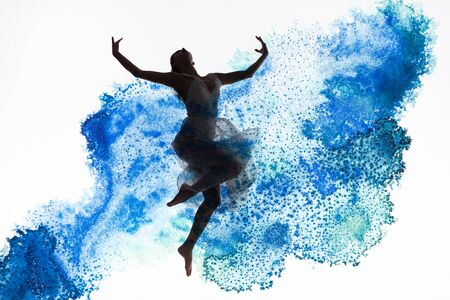 graceful ballerina dancing in blue paint splashes and spills isolated on white Standard-Bild