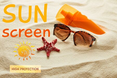 brown stylish sunglasses and sunscreen in orange bottle on sand with starfish and sunscreen, high protection lettering