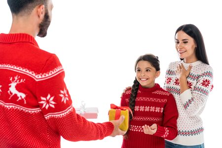 bearded man giving presents to wife and daughter isolated on white