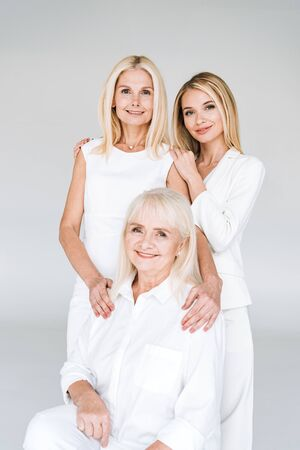 beautiful three generation blonde women isolated on grey Banque d'images