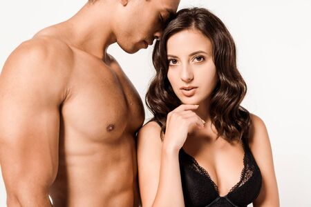 shirtless mixed race man with closed eyes near attractive girl isolated on white 版權商用圖片