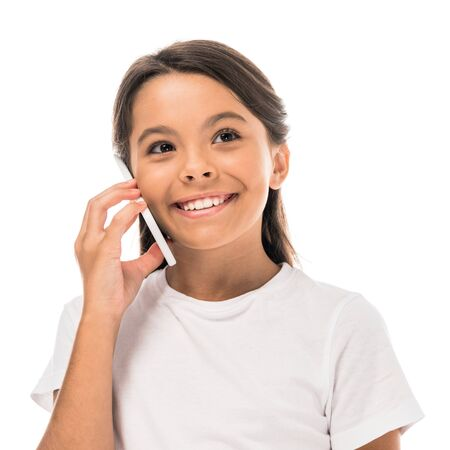 positive kid talking on smartphone isolated on white