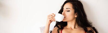 panoramic shot of beautiful girl drinking coffee with closed eyes 版權商用圖片