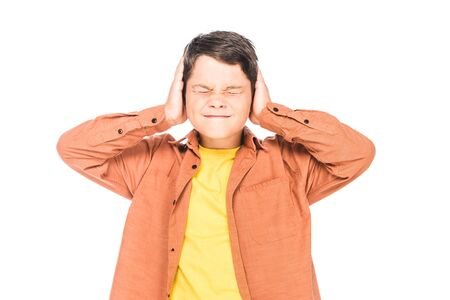 front view of kid covering ears with hands with closed eyes isolated on white
