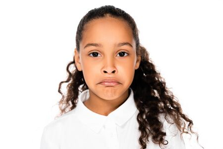 upset african american schoolgirl looking at camera isolated on white