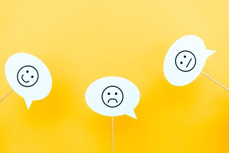 set with emoticons on speech bubbles and sticks on orange Stockfoto