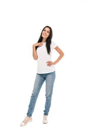 happy woman standing with hand in hip isolated on white